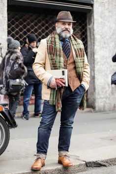 When the temp drops, the options for a man's style increases. The beard helps pull the look together, too. Dignified, indeed.