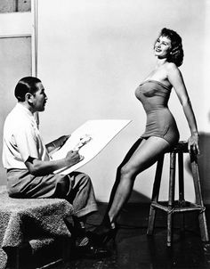 """5'10"""" beauty, Irish McCalla, posing for famed Peruvian pinup artist Alberto Vargas. Since she was born on Christmas Day, McCalla posed nude for the December page in a Vargas calendar. McCalla's attention-getting measurements were reported as 39-24-38 in her heyday."""