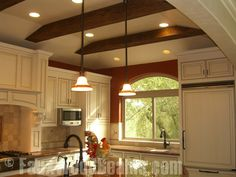 faux wood beam tray ceiling pictures | Faux Wood Ceiling Beams with white cabinets and accent ... | Sara Jan ...