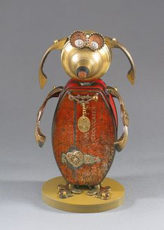Found Object ROBOT SCULPTURE  Ruffin' Roxie by CastOfCharacters23, $155.00  Materials: tin can, lamp part, bell, bottle caps, rubber nut, watch parts, jewelry, dog tag, drawer handles, drawer handle parts, kitchen whisk