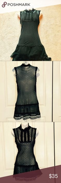 Free people dress Black lacy dress by free people. Picture is Shown  with slip underneath. (Not included) Dress is Sheer. Buttons at the shoulder. Flat pin tucks on upper bodice Free People Dresses