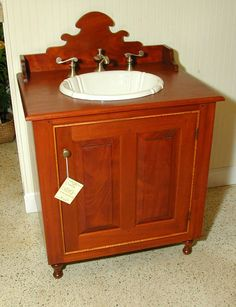 This is from a primitive stitcher i 39 d recognize her touch for Colonial style bathroom vanities