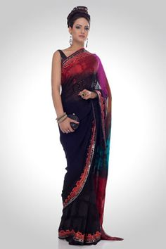 Charm your way with this digitally printed saree. This black georgette drape is laced with sequins and abstract prints. The shimmered multi-layered border, replete with sequins, gives it a quaint look.