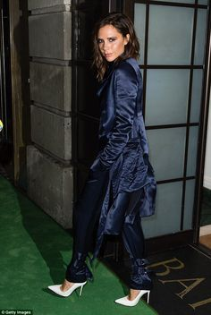 Looking sharp! Victoria Beckham suited up in a stunning satin ensemble for an evening at the A Night to Remember event hosted by The Green Carpet Challenge at BAFTA on Sunday