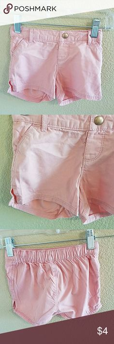 Old Navy Pink Pull On Shorts size 3T Adorable Pink Old Navy Pull On Shorts Size 3T Elasticized Waist Band for a Comfy Fit, there is also Adjustable Waist Tabs! Pockets in front and a Cute Split at the Bottom of the Leg. Faux Button at waist. Excellent condition worn once Old Navy Bottoms Shorts