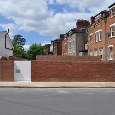 Jack Woolley's Spiral House hides itself behind a brick wall