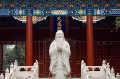 Statue of Confucius at the Confucius Temple in Beijing The main belief system in China during the Qing Dynasty was Confucianism. Confucius was a philosopher and teacher who lived from 551 to 479 BCE in eastern China. He argued that people should live virtuous lives. They should respect their elders and rulers and do their best to fulfil their given roles in society