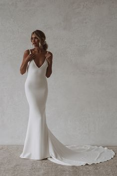 Archie is a sexy and sophisticated combination of both modern and classic. Made with seamless soft, double french crepe, her figure hugging design is created to completely celebrate every curve and turn of the body while draping dramatically with her signature cowl back. #felicitysbridalnz #weddingnz #bridenz #madewithlovebridal #mwlarchie Affordable Wedding Dresses, Home Wedding, Archie, Bridal Collection, Dress Making, Cowl, Perfect Fit, Bride, Celebrities