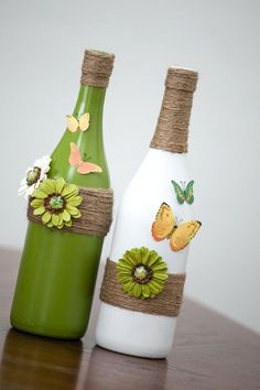This is ONE bottle, displayed here as a set. It is painted antique white with added twine, flowers and butterflies. You can choose which to pair (Bottle Crafts) Glass Bottle Crafts, Wine Bottle Art, Painted Wine Bottles, Diy Bottle, Glass Bottles, Bottle Vase, Reuse Bottles, Painted Vases, Juice Bottles