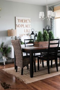 Farmhouse tour of The Wood Grain Cottage - love this fun There's No Place Like Home sign in the dining room eclecticallyvintage.com