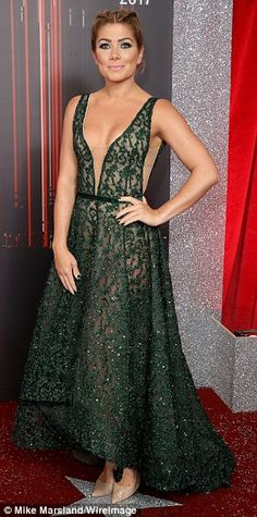 Style stars: Catherine Tyldesley, 33, lead the charge in a plunging nude gown that showcased her gym-honed figure to perfection alongside Hollyoaks' Nikki Sanderson, 33, and Stephanie Waring, 38, at The Lowry Theatre in Manchester (Pictured L-R)