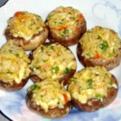 """Crab Stuffed Mushrooms Allrecipes.comCrab Stuffed Mushrooms    By: Wilma Scott  """"This tasty appetizer seasoned with thyme, oregano, and savory. Choose good sized mushrooms, about 2 inches across. When cleaning mushrooms, don't run them under water. They are like little sponges, and will absorb it; just wipe them clean with a damp towel. The filling can be made with fresh, canned, or imitation crabmeat. If using canned, be sure to rinse it first."""""""