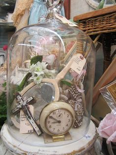What to do with all those meaningful little mementos you have in your life? Cluster them under a display dome and add some thrift shop pretties if you like, says HowToConsign.com, the Resale Shop Directory host!