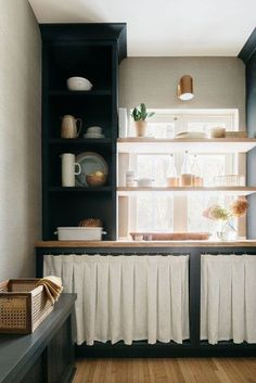 Ready for some inspo? Scroll ahead for 14 modern ways to incorporate cabinet curtains into your kitchen remodel today. #hunkerhome #kitchencabinet #kitchencabinetideas #cabinetideas #skirtedcabinets Open Kitchen Cabinets, Kitchen Cabinet Doors, Kitchen Shelves, Kitchen Reno, Kitchen Ideas, Kitchen Fabric, Kitchen Curtains, Rustic Wooden Shelves, European Kitchens