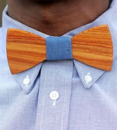 Around these parts, we like to think outside the box and this bow tie is one of those accessories that does just that. This simple yet elegant bow tie is made of beautiful Canary wood, cut and etched by hand and in the center, a beautiful piece of blue denim fabric to complete your dapper accessory. Wear it with any suit and best part? You get all the fanciness without having to worry about knots.