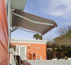 Basic Eko retractable porch awning as small as 8 foot wide. Striped and scalloped valance fabric.
