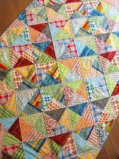 simple half square triangles but the quilting makes it look like more complicated quarter square triangles