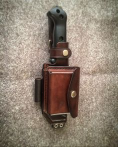 Custom Kabar BK2 sheath with alroids tin pouch mounted to front.