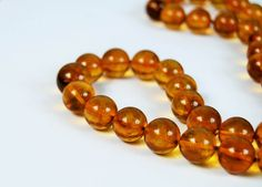 "Pressed Baltic amber necklace, cognac necklace, round amber beads, screw clasp, lithuanian amber, 12 m amber beads, 14 mm amber, 24"" long by AmberGiftLT on Etsy"