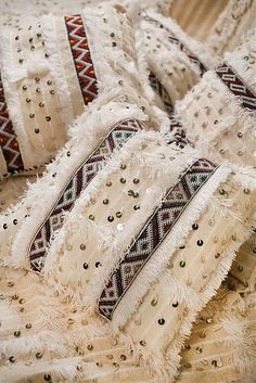 From Tao of Dana--- Handira Mania: My Moroccan Wedding Blanket Lust! Moroccan Design, Moroccan Style, Wool Pillows, Cushions, Middle Eastern Decor, Moroccan Wedding Blanket, Square Pouf, Moroccan Bedroom, Wedding Pillows