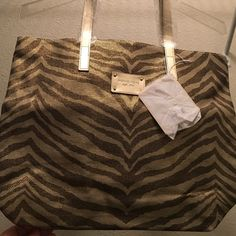 MK NWT CANVAS MED TOTE. New pretty, animal Print design. In style.  This tote is the free tote when you spend $175. On a Michael Kors purchase; so it cost me $175. Lol MICHAEL Michael Kors Bags Totes