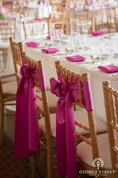 Pink Chair Bows | www.georgestreetphoto.com #DREAMWEDDING I love the bright colors, I will have lots of bright purples at my wedding.
