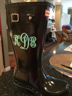 Script monogram on kid's Hunter rain boots with Oracal Vinyl. Made with Silhouette machine.