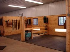organization and storage for wash stalls. girths hanging on wall. hooks to hang bridles. saddle rack with shelves as the divider and space for polos and bell boots Barn Stalls, Horse Stalls, Horse Barns, Dream Stables, Dream Barn, House With Stables, Barn Layout, Horse Farm Layout, Horse Tack Rooms
