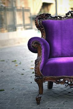 I love the gingerbread on this old chair. I especially love the purple velvet upholstery.