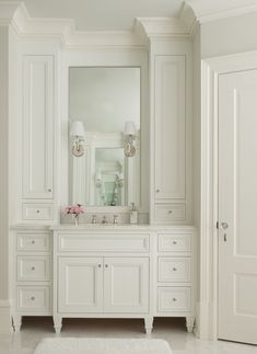 Thomas O'Brien Jonathan Sconces mount on a vanity mirror flanked by built-in cabinets over an ivory French style washstand with feet. Bathroom Styling, Bathroom Interior Design, Interior Decorating, Decorating Ideas, French Country Bedrooms, French Country Decorating, Country Bathrooms, Farmhouse Bathrooms, Victorian Style Bathroom