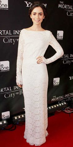 Lily Collins hit the Toronto premiere of Mortal Instruments: City of Bones in a demure-yet-sexy long-sleeve ivory lace Houghton column with an open back.