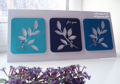 handmade card from Huguenot Girl: Shades of Blue ... short and wide format ... panels with negative cut leafy branch negative die space ... could use paint chips for a closer matching of blue tones ... luv it!