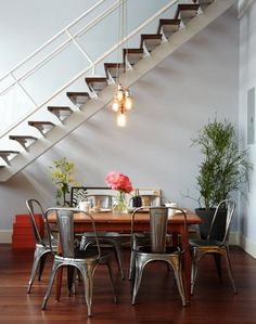 Wood, metal, red, and green grounding high ceilings and white