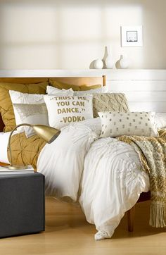 Gold and ivory bedding looks so fresh.