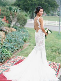 Gorgeous open back Watter Wtoo wedding dress: http://www.stylemepretty.com/2016/05/27/red-boho-style-ranch-wedding/   Photography: Carmen Santorelli - http://carmensantorellistudio.com/