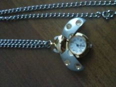 Ladybug watch necklace!  I love my hubby!<3