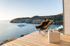 Sit back, relax and take in that stunning Greenland view in an equally beautiful Sheepskin Butterfly Chair!