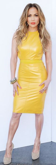 Who made  Jennifer Lopez's zebra print jewelry, yellow leather dress, and nude suede pumps?