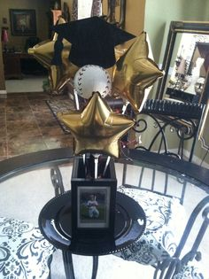 Graduation centerpiece(love this without he baseball for girls grad)