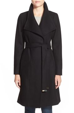 Gleaming hardware polishes the elegant look of this long wrap coat cut from a cashmere-infused wool blend and topped with a face-framing funnel neckline. This coat is the perfect essential to have on those cold days.