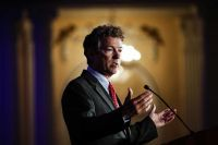 """Senator Rand Paul appeared passionate with hands wide open like a Sunday morning preacher before the offering plates are passed around. His face was tense, but not too distressed. In the senator's mind, he proclaimed: """".....how do you like me now, I'm working this crowd for some serious campaign contributions!"""""""