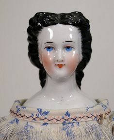 China head doll c. 1860's Waterfall hairstyle, delicate facial features, brush strokes around the hairline.