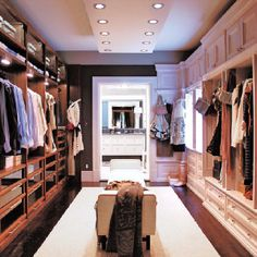 Love this idea. Not usually a fan of walkthrough closets that lead to the bathroom, but how great would it be have this as a robe, pajama, linen closet? Then have the real master closet still...elsewhere in the suite.