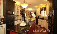 sweet kitchen - I love the European feel of the cabinets. The house is on City Lake in Cambellsville, KY - and is for sale! 100+ more images of this place - dream with me!  http://www.kylandsales.com/126CoxCove/KentuckyLakeHouseForSaleCove.html