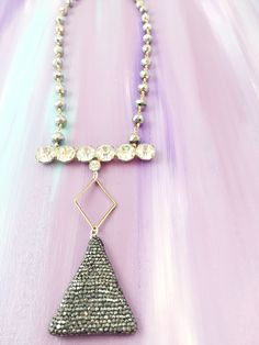 """""""Don't Go It Alone"""" - 1950's rhinestone bar brooch paired with a geometric marcasite pendant on silver beaded glass chain"""