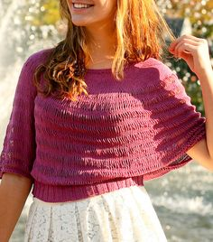 Free Knitting Pattern for Rosarian Top -This pullover is combination of sweater and poncho, wrapping the shoulders and upper arms with elbow length arm openings just above the fitted waistband. Knit with dropped stitches, it creates a flattering silhouette for almost everyone. Designed by Melinda VerMeer. XS (S, M, L, 1X, 2X 3X)