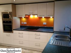 Tangerine glass splashback. We create bespoke glass products in any colour, pattern or image. Whether it's a splash back, worktop or table top, it's possible to personalise your glass to suit your existing decor, or taste. Visit our website to discover more.