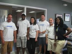 The group of volunteers from Carmax Charleston who came to spend time with youth Friday in the Center for Life rec center.