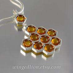 HONEYCOMB silver pendant with amber and white by WingedLion