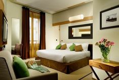 Babuino 181 in Rome, Italy - Deluxe Room: The deluxe room features a king-size bed with Frette sheets and a silk-filled duvet by Bianco Seta.